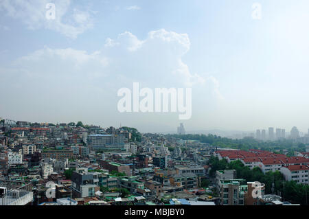 A view of the Yongsan district of Seoul, South Korea in the hot, rainy summer monsoon season. - Stock Photo