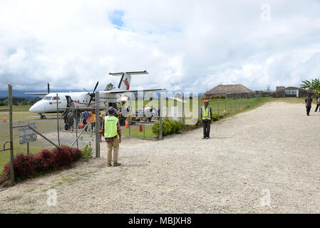 A small airplane just landed at Tari airport, Papua New Guinea - Stock Photo