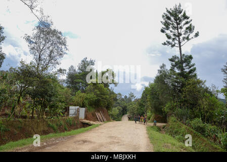 An unpaved road in the Valley of Tari, Papua New Guinea - Stock Photo