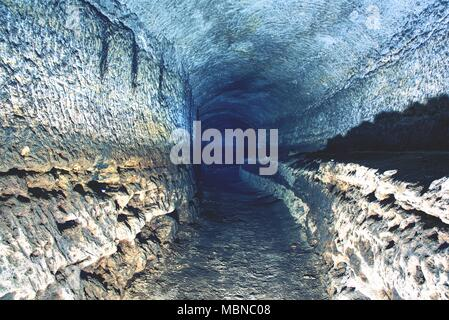 The old sandstone water tunnel, mined caves.  The cave. Sandstone tunnel moistened walls. Dry channel carved in the rocky underground - Stock Photo