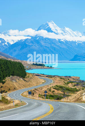 new zealand south island new zealand winding road through mount cook national park next to the glacial lake Pukaki new zealand  mackenzie district nz - Stock Photo