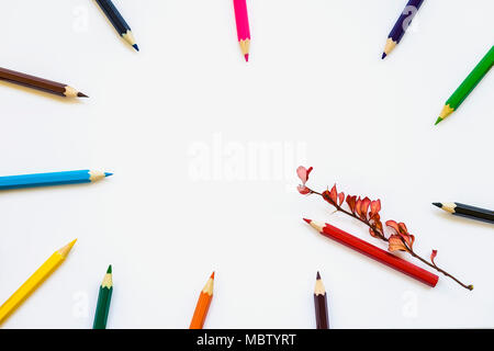 Colored pencils on white notebook, album background, red autumnal branch. Concept back to school. Space for text - Stock Photo