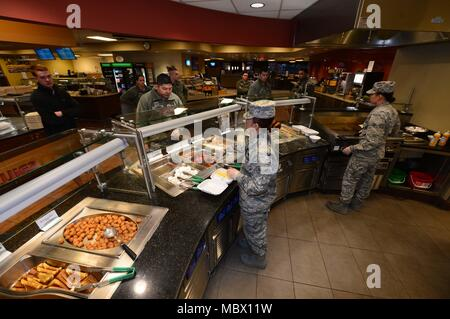 Personnel from the 28th Force Support Squadron serve customers breakfast inside the Raider Café at Ellsworth Air Force Base, S.D., Jan. 12, 2018. Having won the Hennessey award several times in the past, an award recognizing the best dining facilities in the Air Force, food service personnel of the 28th FSS gear up to compete in this year's competition. (U.S. Air Force photo by Airman 1st Class Donald C. Knechtel) - Stock Photo