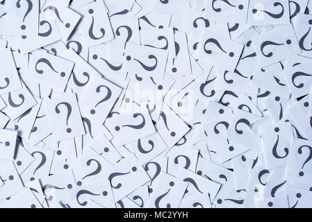heap of white paper note with QUESTION MARK as background. FAQ and Q&A concept - Stock Photo