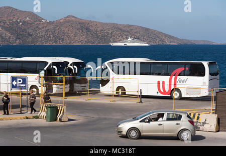 Tour bus parking area on the waterfront in Agios Nikolaos, Crete, Greece - Stock Photo