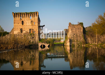 The ruins of Borghetto sul Mincio towers bridge on the river, with the pedestrial lane. Veneto region, Italy. - Stock Photo
