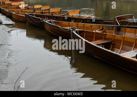 Lined up wooden rowing boats in Durham - Stock Photo