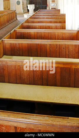 A view of a row of box pews in the parish church of St Mary the Virgin at Wiveton, Norfolk, England, United Kingdom, Europe. - Stock Photo