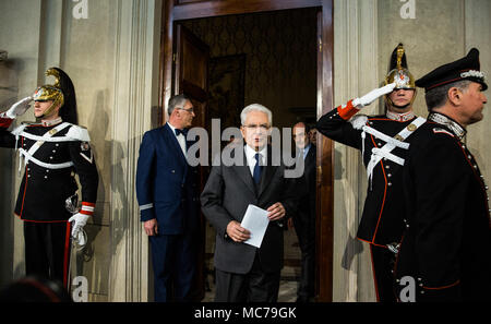 Rome, Italy. 13th Apr, 2018. Italian President Sergio Mattarella(C) leaves at the end of the second day of consultations at the Quirinale Palace in Rome, capital of Italy, on April 13, 2018. The second round of talks to form a national government has failed to produce a workable majority, Italian President Sergio Mattarella told the country in a live statement on Friday. Credit: Jin Yu/Xinhua/Alamy Live News - Stock Photo