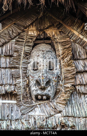 A wood carved mask Haus Tambaran (men's or spirits house) of Kaminibit village, East Sepik Province, Papua New Guinea - Stock Photo