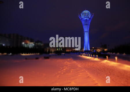 Night view of the Bayterek Tower in Nur-Sultan, Kazakhstan, at -29 degrees Celsius - Stock Photo