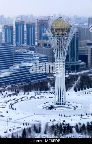 The Capital's skyline and the Bayterek Tower at -24 degrees Celsius in Nur-Sultan, Kazakhstan - Stock Photo