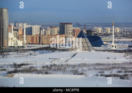 Palace of Peace and Reconciliation and the Kazakh National University of Arts in Nur-Sultan, Kazakhstan, at -24 degrees Celsius - Stock Photo