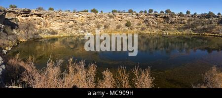 Wide Panoramic Landscape of Montezuma Well, a Natural Limestone Sinkhole in Montezuma Castle National Monument Arizona USA - Stock Photo