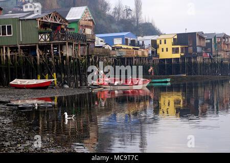 Colorful palafito houses near the sea in Castro, Chiloe Island in Chile. - Stock Photo