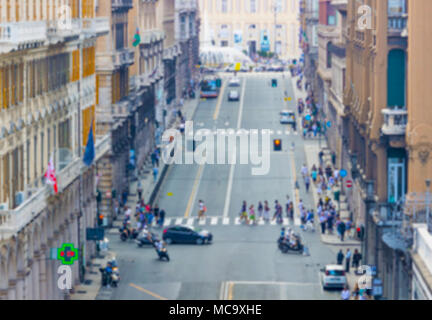 Blurred image of people and traffic moving in crowded city street. Art toning abstract urban background. Crowd of traffic anonymous people walking on  - Stock Photo