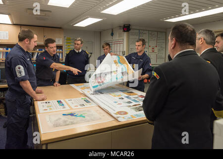 CONSTANTA, Romania, Feb 1. 2018 SNMCMG2 Commander, Justin Hains and HMS Enterprise acting Commanding Officer, Commander Warren, welcomes Romanian Navy Hydrographic and Mine Warfare officers for an official visit aboard SNMCMG2 flagship HMS Enterprise. - Stock Photo