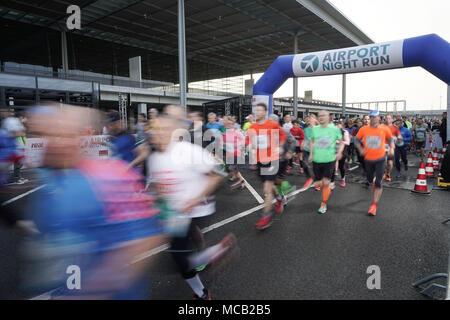 14 April 2018, Germany, Berlin-Schoenefeld: Start of the half marathon at the 12th Airport Night Run at the future Berlin Brandenburg capital airport. Photo: Jörg Carstensen/dpa - Stock Photo