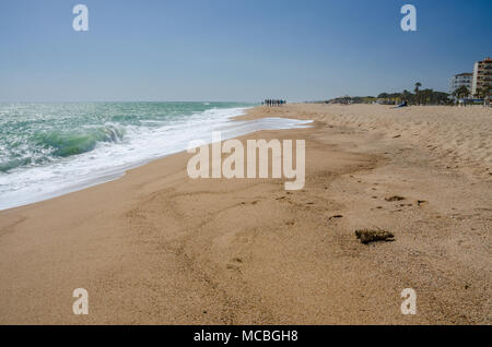Looking down an empty beach at Santa Susanna in the Costa Brava region of Spain. - Stock Photo