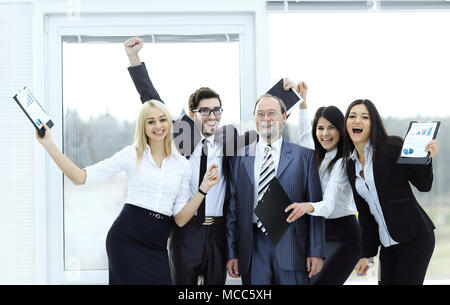 happy business team raising hands, rejoicing.the concept of success - Stock Photo