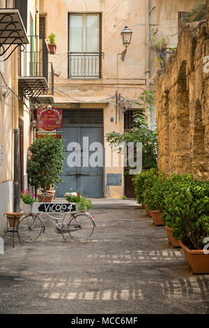 A backstreet in Palermo, Sicily, Italy, with an old bicycle outside a Bed and Breakfast. - Stock Photo