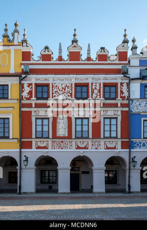 Close up view of colorful buildings in the historic Great Market Square at Zamosc, Poland. Photo taken on a sunny spring morning. - Stock Photo