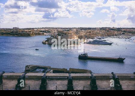 Valletta, Malta. Grand harbour view from Upper Barrakka Gardens over saluting battery guns - Stock Photo