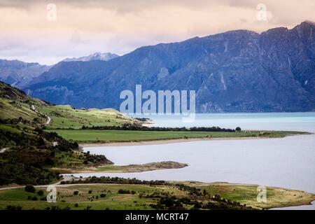 Clouds and sun across Lake Hawea, South Island, New Zealand. - Stock Photo
