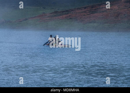 Beautiful view of boating in thekkady lake and periyar tiger reserve forest, fisherman and fisher women on lake side, view from boats - Stock Photo