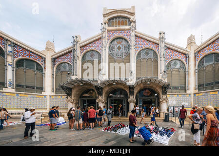 Valencia, Spain - June 3, 2017: Sellers and customers outside of Mercado Central or Central market. - Stock Photo