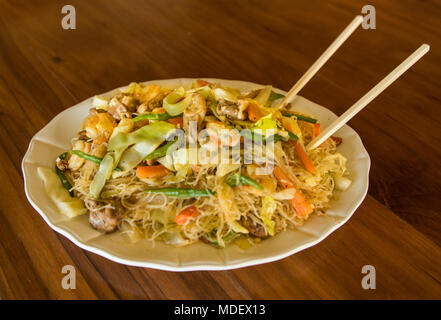 Fried Rice Noodles With Shrimp, Chicken and Vegetables - Stock Photo
