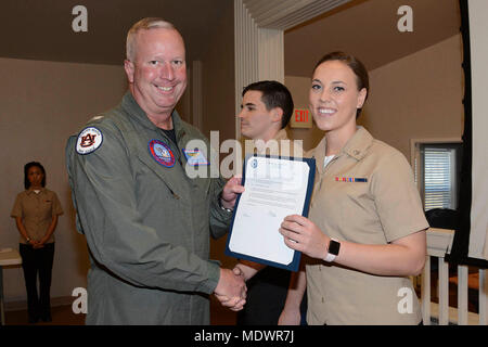 PENSACOLA, Fla. (Dec. 1, 2017)- Naval Air Station (NAS) Pensacola Commanding Officer, Capt. Christopher Martin, presents AC3 Candace Hall of Denver, Co., with a letter detailing her promotion at a frocking ceremony onboard the base, Dec. 1. (U.S. Navy photo by Gregory Mitchell/NAS Pensacola Public Affairs Office) - Stock Photo