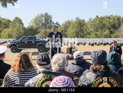 171216-N-DC046-002  PENSACOLA, Fla. (Dec. 16, 2017) Rear Adm. Kyle Cozad, commander of Naval Education and Training Command, speaks during a Wreaths Across America event at Barrancas National Cemetery at Naval Air Station Pensacola. (U.S. Navy photo by Lt. Cmdr. Katherine Meadows/Released) - Stock Photo