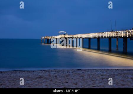 Illuminated pier, Niendorf, Baltic Sea, Timmendorfer Strand, Lübeck Bay, Schleswig-Holstein, Germany - Stock Photo