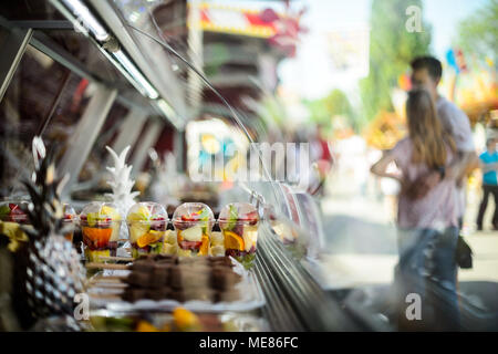 Stuttgart, Germany. 21st April, 2018.  Fruit for sale at the Fruehlingsfest (lit. Spring Festival) at the Cannstatter Wasen. The Spring Festival runs from 21 April to 13 May 2018. Photo: Sina Schuldt/dpa Credit: dpa picture alliance/Alamy Live News - Stock Photo