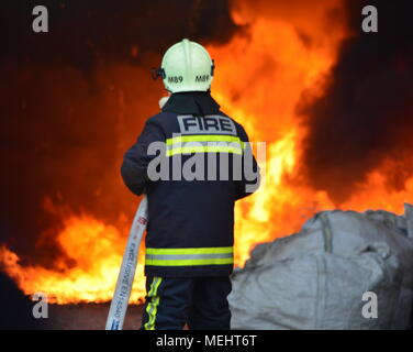 Kashar, Tirana-Albania, 22 April 2018. Huge fire burns completely a recycling company  in Kashar,  10 fire-units already on the scene struggling to extinguish the flames. NO injures or fatalities are reported Credit: Antonio Cakshiri/Alamy Live News - Stock Photo