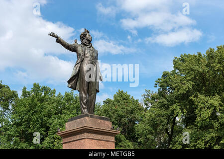 RUSSIA, SAINT PETERSBURG - AUGUST 18, 2017: Monument to the great russian poet Alexander Pushkin on Arts Square and The State Russian Museum of His Im - Stock Photo