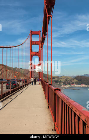 Pedestrians on the sidewalk, with the speed limit sign for vehicles on the Golden Gate Bridge, California, United States. - Stock Photo