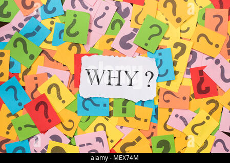 colourful paper note with question mark and white paper with word WHY. why concept background - Stock Photo