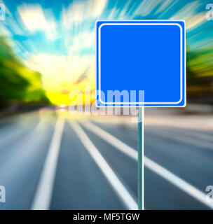 Template, blank, clean blue road sign with blurred speedy background in sunset. Copy space. - Stock Photo