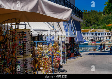 Thassos, Greece - August 03 2017: Greek island souvenir shop. Outdoor showcase view of gifts and souvenirs at Limenas Town Thassos island. - Stock Photo