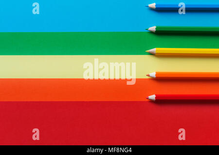 Colored pencils on a multicolored background.A horizontal and graphic composition,rainbow effect - Stock Photo