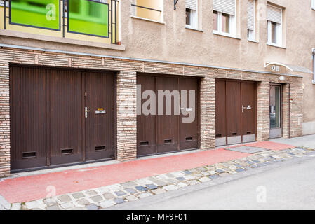 garage gates for cars in a building - Stock Photo