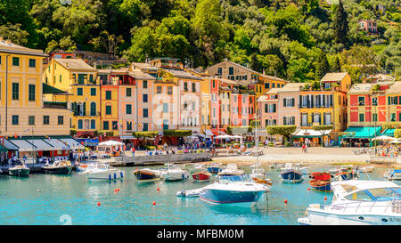 Portofino, is an Italian fishing village, Genoa province, Italy. A vacation resort with a picturesque harbour and with celebrity and artistic visitors - Stock Photo