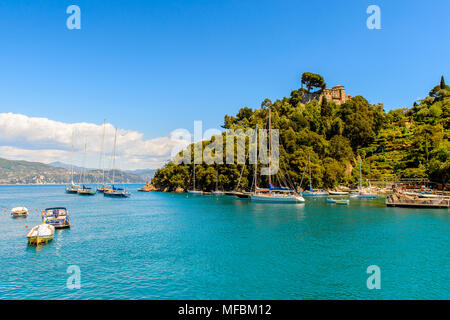 Harbour of Portofino, is an Italian fishing village, Genoa province, Italy. A vacation resort with a picturesque harbour and with celebrity and artist - Stock Photo