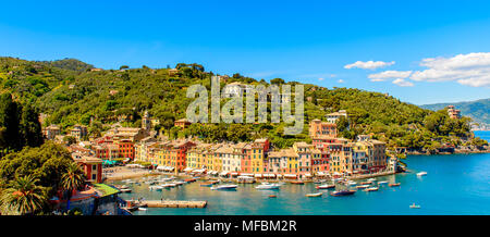 Panoramiv view of Portofino, is an Italian fishing village, Genoa province, Italy. A vacation resort with a picturesque harbour and with celebrity and - Stock Photo