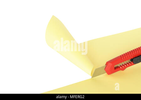 Red knife cutting yellow paper sheet. Isolated on white with clipping path - Stock Photo
