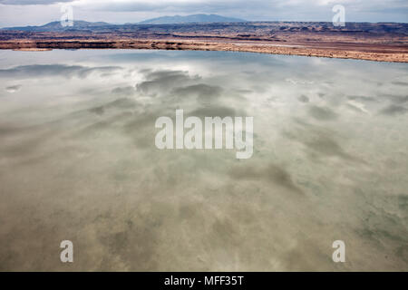 View of Lake Magadi with clouds reflected in its still waters. Rift valley. Kenya - Stock Photo