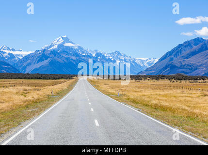 new zealand south island new zealand a straight empty road with no traffic in mount cook national park new zealand - Stock Photo