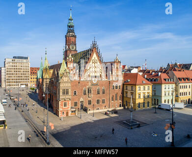 Old Gothic city hall in Wroclaw (Breslau) in Poland, built in 14th century and historic market square (Rynek). Aerial view. Early morning - Stock Photo